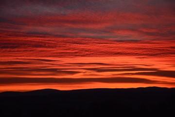 Fototapeten Kastanienbraun Scenic View Of Landscape Against Sky During Sunset