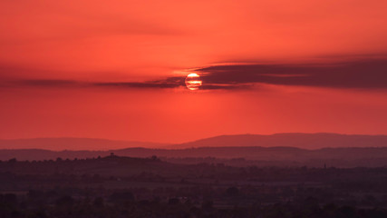 Foto auf Gartenposter Koralle Silhouette Landscape Against Sky During Sunset