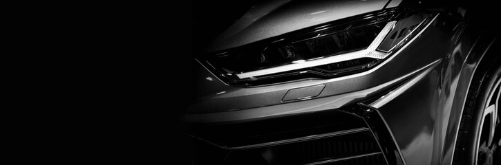 Wall Mural - Detail on one of the LED headlights super car.copy space,black and white