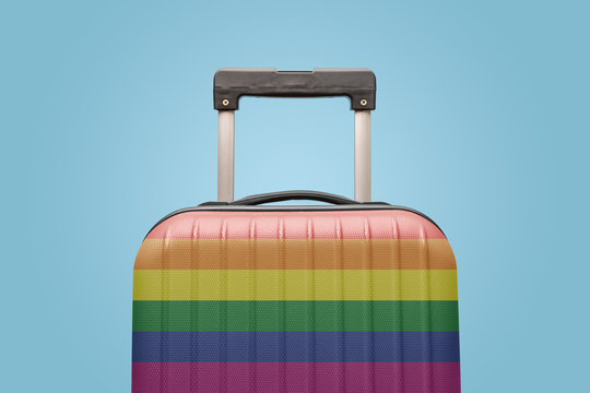 Luggage with gay pride flag vacation concept