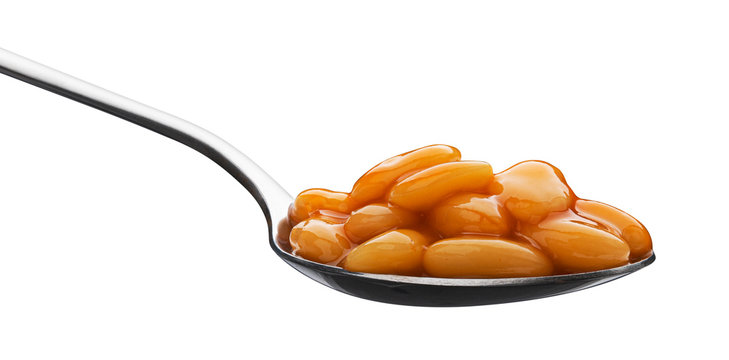 Spoon of baked beans in tomato sauce isolated on white background