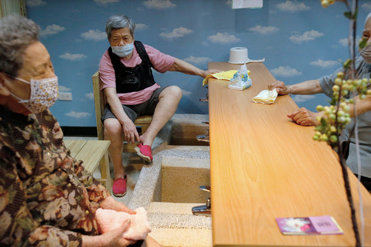 Seniors wear masks against coronavirus disease (COVID-19) in Taipei