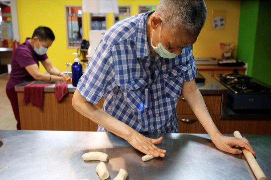 Seniors bake bread at elderly day care center in Taipei
