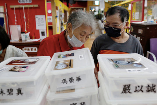 Senior prepare for afternoon snack elderly day care center in Taipei