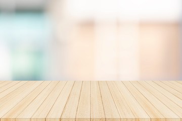 Fotomurales - Wood table top on blurred abstract background - can be used for display or montage your products
