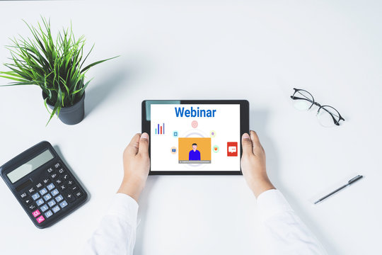 Doctor using a tablet computer for online training webinars. E-learning browsing connection and cloud online technology webcast concept. tablet mockup with clipping path on screen.