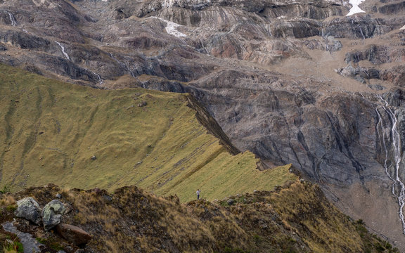 Person standing on a mountain ridge
