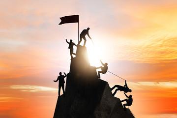 Obraz Concept of teamwork with team climbing mountain top - fototapety do salonu