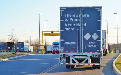 WEST DEPTFORD, NJ -23 FEB 2020- An Amazon Prime delivery tractor trailer truck entering an Amazon fulfillment distribution logistics facility in New Jersey.