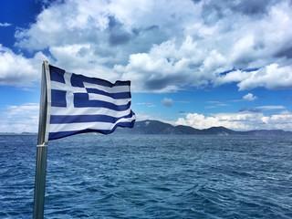 Greek Flag At Beach Against Sky