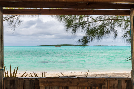 View of Coco Plum beach through the window of a small wooden house (Great Exuma,  Bahamas).