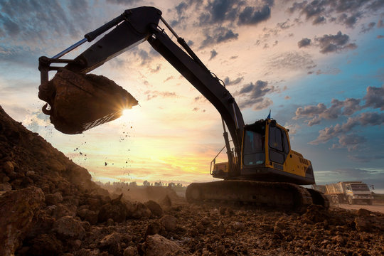 excavator at sandpit during earthmoving works in the construction site.