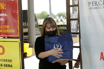 Cristina Lopez holds a bag with the ashes of her brother Octavio Lopez, a nurse who worked at the General Hospital of the Mexican Institute of Social Security (IMSS), and died of the coronavirus disease (COVID-19), after his cremation in Ciudad Juarez