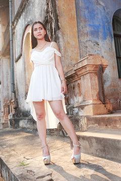 Full Length Of Female Model Posing By Old Building