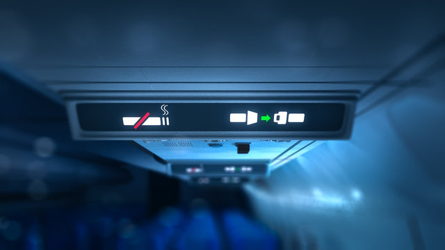 no smoking and fasten seatbelts signs inside an airplane, 3D rendering