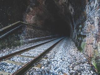 Spoed Fotobehang Spoorlijn Railroad Tracks In Old Tunnel