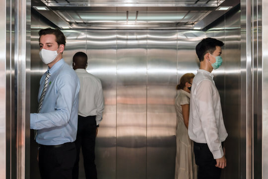 new normal practise keep social distancing in elevator at office