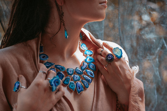 close up of woman hands with with gem stones accessories outdoors