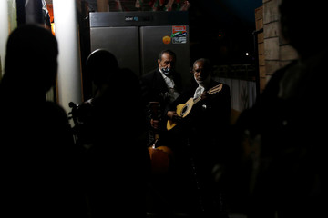 A Mariachi group waits to perform for an online audience following a voluntary lockdown as the outbreak of the coronavirus disease (COVID-19) continues in Mexico City