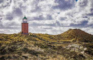 Lighthouse On Sand Dune Against Sky Fototapete