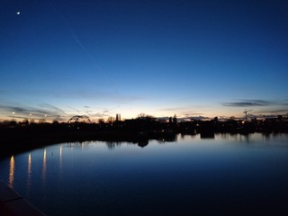 Buildings Lit Up At Night At Lakeshore - fototapety na wymiar