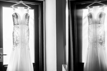 wedding dress in the room with reflection , monochrome