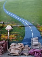 Foto auf Gartenposter Olivgrun Empty Narrow Road Along Countryside Landscape