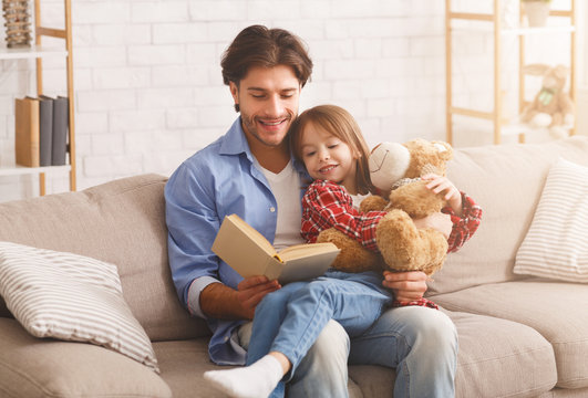 Daddy and daughter reading funny stories together