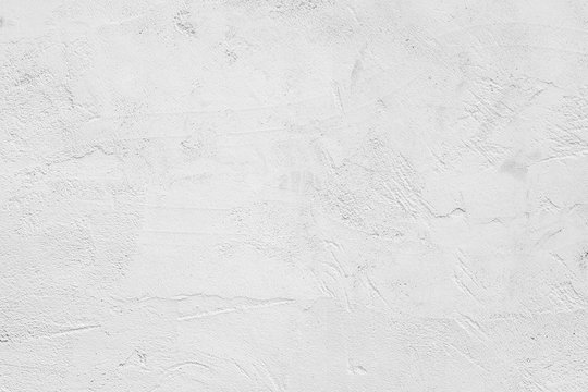 White abstract background. White stucco wall of an old house.