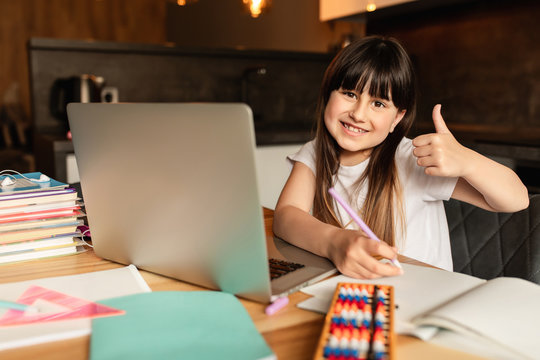 Online learning. Happy girl studying at home. Education and distance learning.