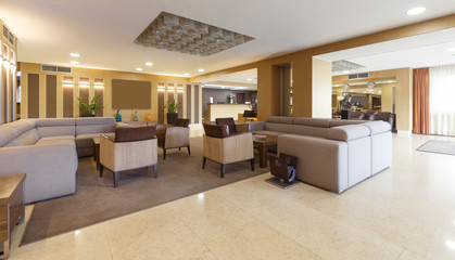 Fototapeta Gray sofas and armchairs in hotel lounge room obraz