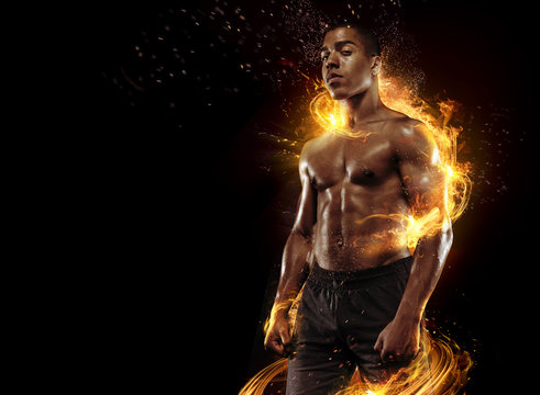 Sport. Dramatic portrait of professional athlete. Winner in a competition. Fire and energy.