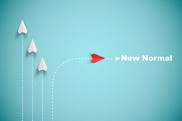 Red paper plane out of line with white paper to change disrupt and finding new normal way on blue...