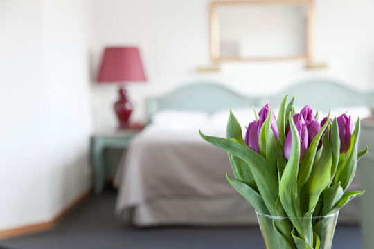 Hotel room with fresh tulips