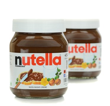 NIEDERSACHSEN, GERMANY SEPTEMBER 13, 2014: Two glass jars of Ferrero Nutella chocolate spread on a white background