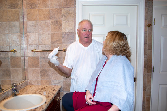 Couple doing home hair care