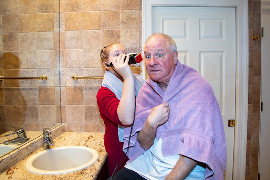 Man being home grooming during pandemic