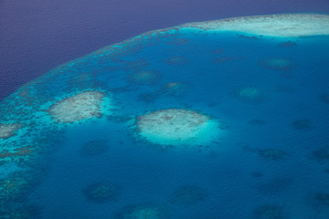 Fototapete - Tropical islands and atolls in Maldives from aerial view. Maldives consist of many islands and atolls which are the world top beauty.