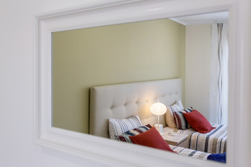 Modern bedroom, which is reflected in the mirror. European hotel design and inside.