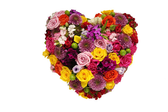 Heart made of flowers on white