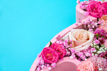 Natural floral background. Roses in a soft color scheme close-up on a pastel blue background.