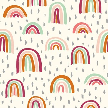 Vector seamless repeat pattern with sloppy thick hand drawn marker squiggly uneven rainbows in earthy indie modern colors, half-drop on a cream ivory background with droplet brush marks