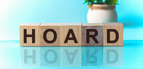 HOARD word written on wood block. HOARD text on wooden table for your desing, concept.