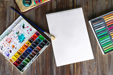 art painting, color pencils, brushes, watercolor paints, paper and crayon pastel chalks. Flat lay...