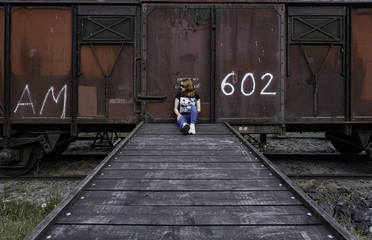 Girl in front of old train