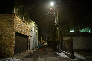 Wall Mural - Dark and eerie urban city alley at night in the winter