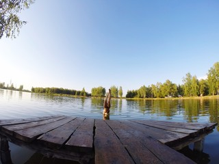 Printed kitchen splashbacks Lake Young Woman Diving In Lake Against Clear Sky