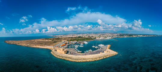 Spoed Fotobehang Oude gebouw Cyprus. Paphos castle, aerial panorama from drone. Medieval port castle in harbour on Mediterranean coast.