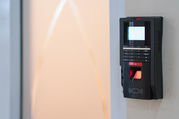 fingerprint scanner on wall to record working time or enter security system