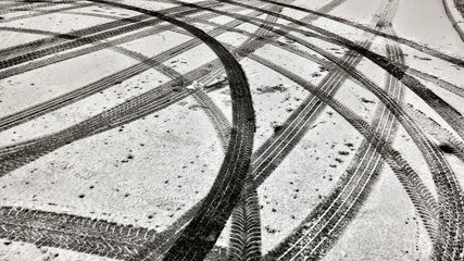 Fotomurales - High Angle View Of Tire Tracks On Snow Covered Road
